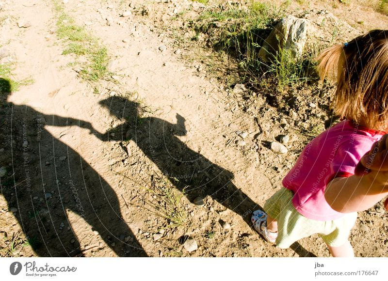 Safety and security Colour photo Copy Space top Day Shadow Contrast Silhouette Bird's-eye view Downward Looking away To go for a walk Trip Summer Parenting