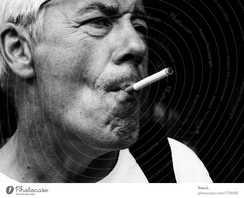 extreme smoking Black & white photo Exterior shot Day Shallow depth of field portrait Looking away Leisure and hobbies Trip Summer Human being Masculine Man