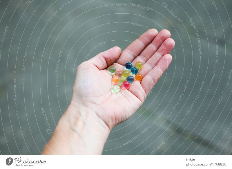 coloured glibber balls Lifestyle Leisure and hobbies Playing Marble Hand Palm of the hand 1 Human being Sphere To hold on Round Multicoloured Infancy Mixed