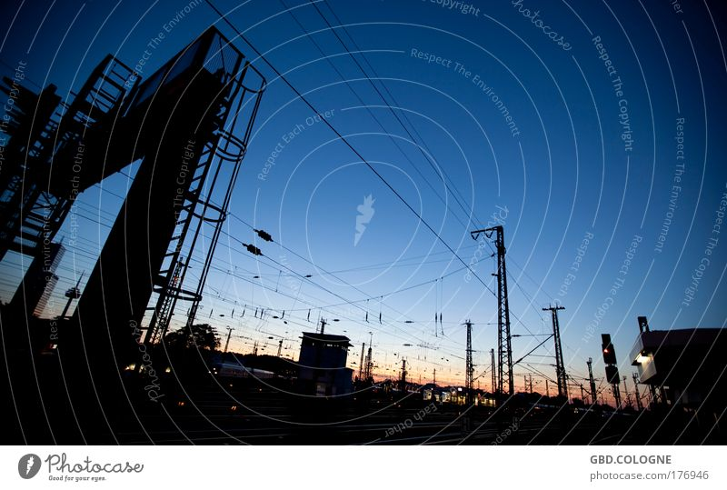 Sky Blue Summer Vacation & Travel Black Wait Horizon Railroad Logistics Night sky Exceptional Railroad tracks Train station Traffic infrastructure Bizarre