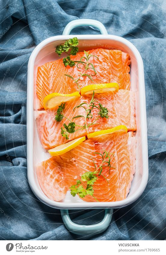 Salmon fish fillet with lemon in bowl Food Fish Herbs and spices Cooking oil Nutrition Lunch Banquet Organic produce Vegetarian diet Diet Bowl Style