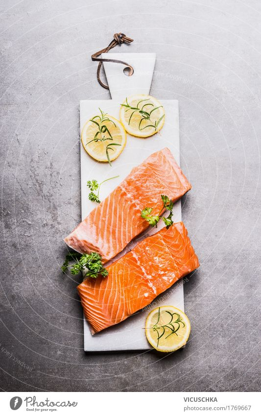 Salmon fish fillet with lemon on white chopping board Food Fish Herbs and spices Nutrition Banquet Organic produce Vegetarian diet Diet Crockery Style Design