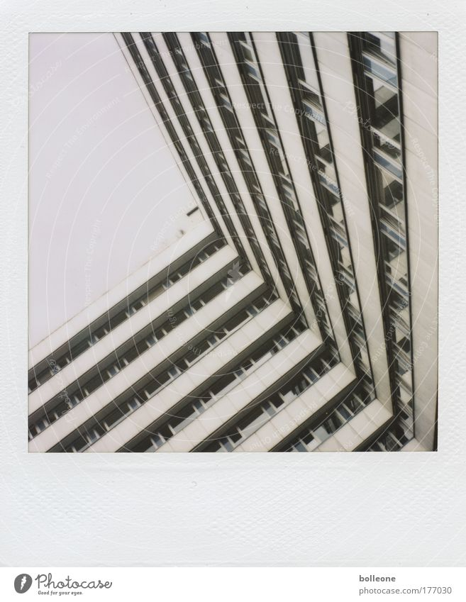 very oblique Colour photo Subdued colour Polaroid Copy Space left Day Town Deserted High-rise Manmade structures Building Architecture Facade Sharp-edged Cold