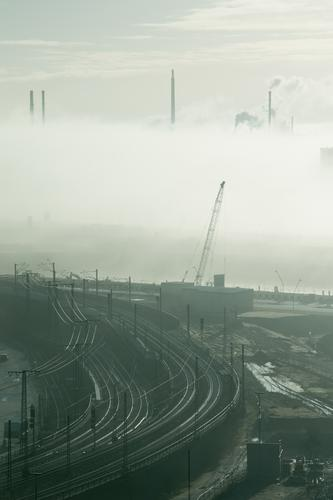 City Dark Transport Fog Energy industry Future Industry Hamburg Construction site Logistics Factory Railroad tracks Traffic infrastructure Chimney Build