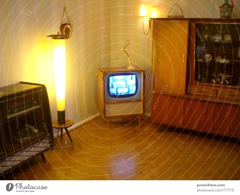 "50s living room Joy Flat (apartment) Furniture Lamp Clock Living room Historic The fifties from that years. ""Living room,"" tube TVs Interior design Colour photo"