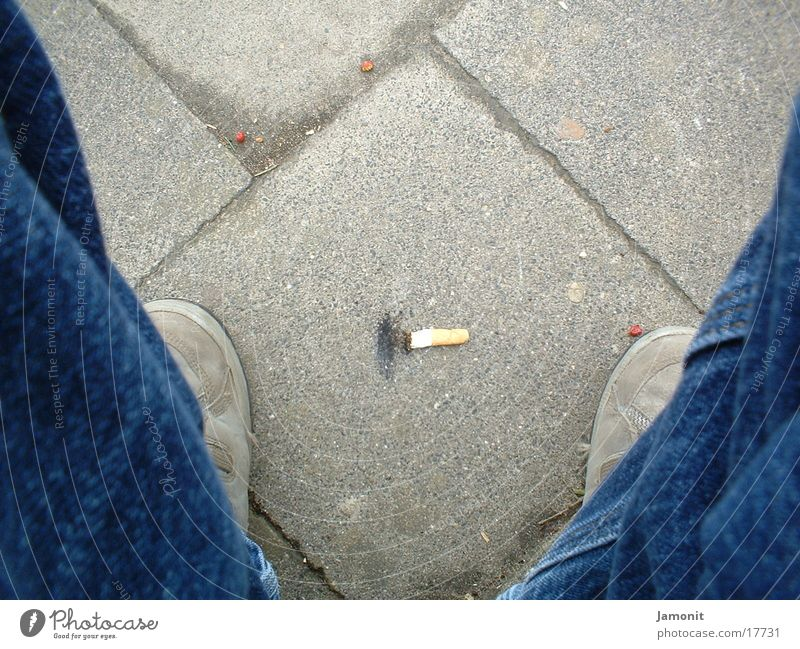 Cigarrette on the floor Floor covering Footwear cigarrette Stone Ashes