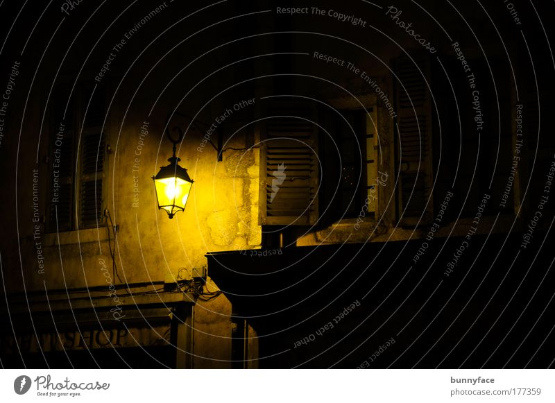 in lantern light Colour photo Exterior shot Deserted Copy Space right Night Artificial light Silhouette City trip Town Old town Wall (barrier) Wall (building)