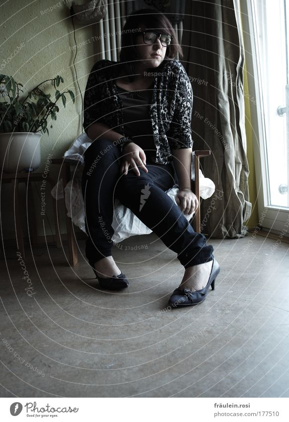 In my sister's shoes. Interior shot Day Shadow Contrast Central perspective Full-length Front view Downward Looking away Armchair Room Human being Feminine