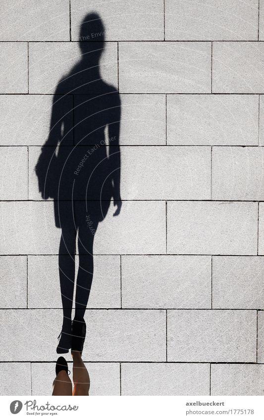 shadow of a woman walking on pedestrian street Lifestyle Elegant Human being Feminine Woman Adults Feet 1 Pedestrian Street Walking Long Above Sidewalk Footpath