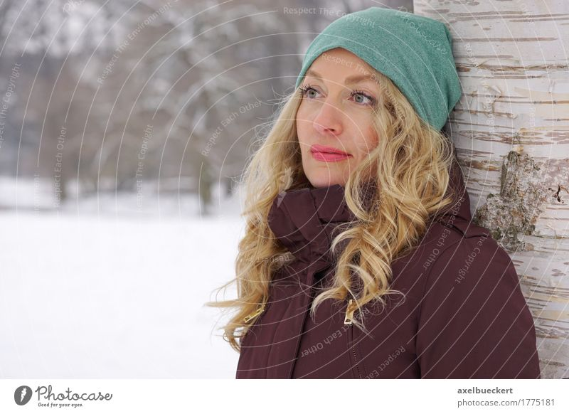 pensive woman leaning against tree in winter Lifestyle Leisure and hobbies Winter Snow Winter vacation Human being Feminine Young woman Youth (Young adults)