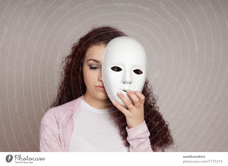 sad girl hiding face behind mask Human being Woman Youth (Young adults) Young woman Girl 18 - 30 years Adults Sadness Emotions Feminine Moody Copy Space Mask Long-haired Hide Brunette