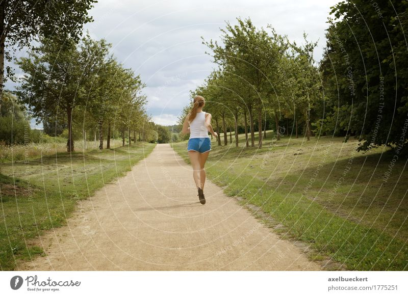 young woman jogging Human being Woman Nature Youth (Young adults) Summer Young woman Landscape Relaxation Girl 18 - 30 years Adults Lanes & trails Sports