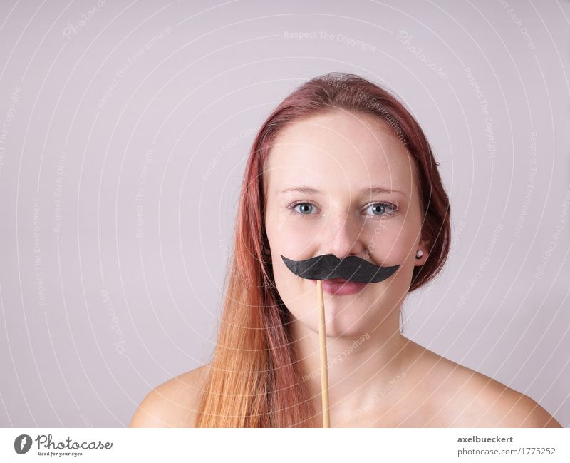 young woman with fake moustache Human being Woman Youth (Young adults) Young woman 18 - 30 years Face Adults Funny Lifestyle Feminine Masculine Copy Space Smiling Long-haired Bizarre Identity