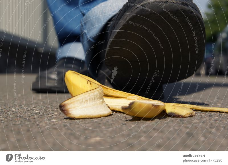 person about to slip on a banana peel Fruit Human being Man Adults Feet 1 Pedestrian Street Footwear Dangerous Banana Slapstick Ground Skid Slippery surface