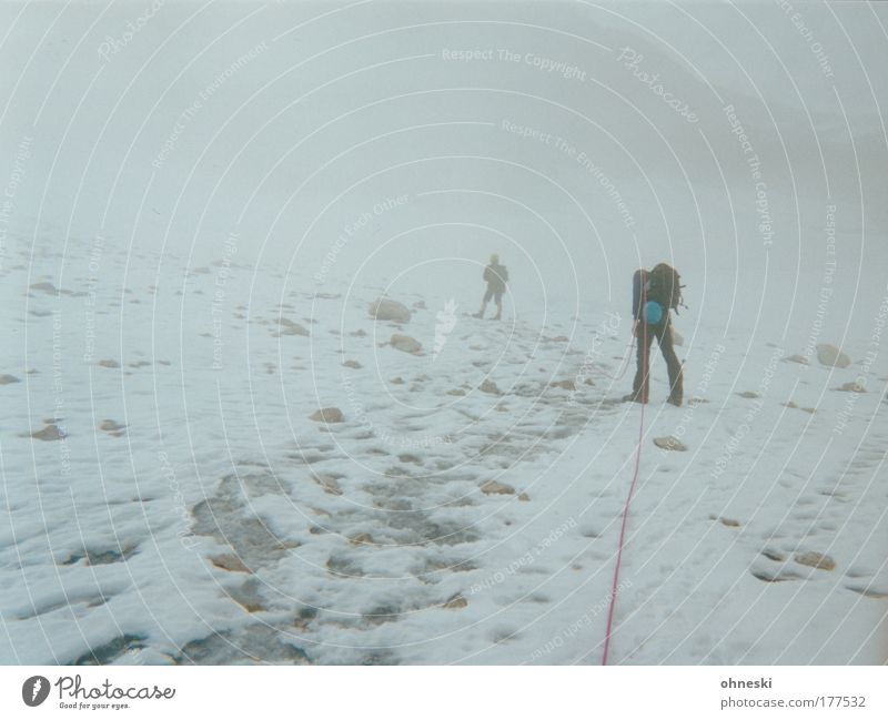 Human being White Winter Far-off places Snow Mountain Freedom Gray Ice Back Fog Hiking Masculine Adventure Rope Frost