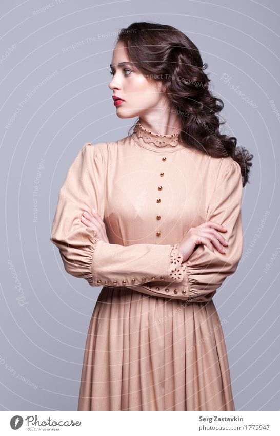 Portrait of young beautiful woman in retro beige dress Elegant Style Beautiful Skin Face Manicure Make-up Girl Woman Adults Hand Fashion Dress Brunette Thin