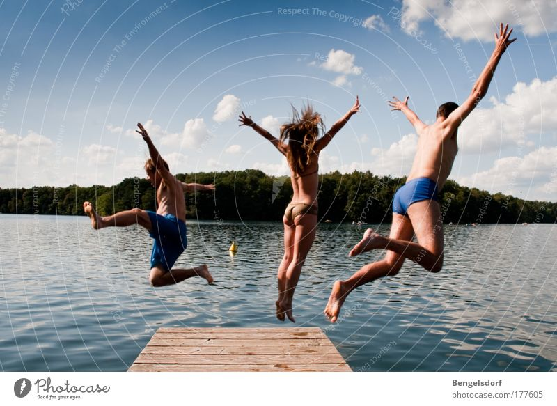 Human being Sky Nature Youth (Young adults) Water Vacation & Travel Summer Clouds Man Freedom Movement Jump Lake Woman Swimming & Bathing Leisure and hobbies