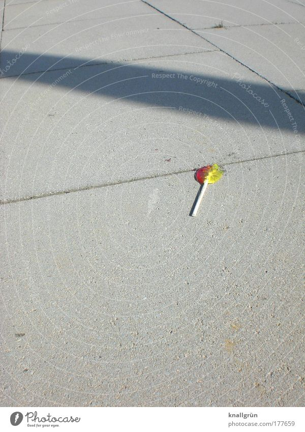 Sucked to death Colour photo Exterior shot Deserted Copy Space left Copy Space top Copy Space bottom Neutral Background Shadow Sunlight Food Candy Lollipop