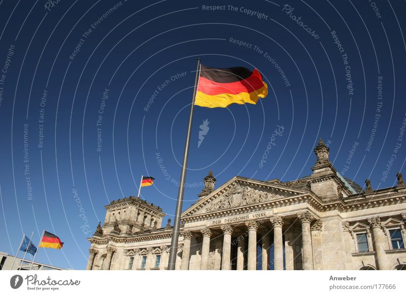 Reichstag in Berlin with flags Colour photo Multicoloured Exterior shot Deserted Copy Space left Copy Space top Neutral Background Day Sunlight Worm's-eye view