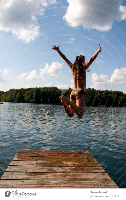 Human being Youth (Young adults) Water Beautiful Vacation & Travel Sun Summer Woman Far-off places Feminine Freedom Happy Jump Lake Air Body