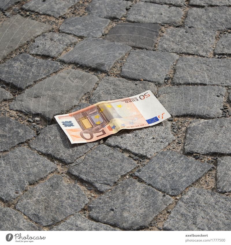 The money's on the street. Street Money Lose Euro 50 Loose change Bank note Cobblestones Sidewalk Doomed Find Lie Colour photo Exterior shot Deserted