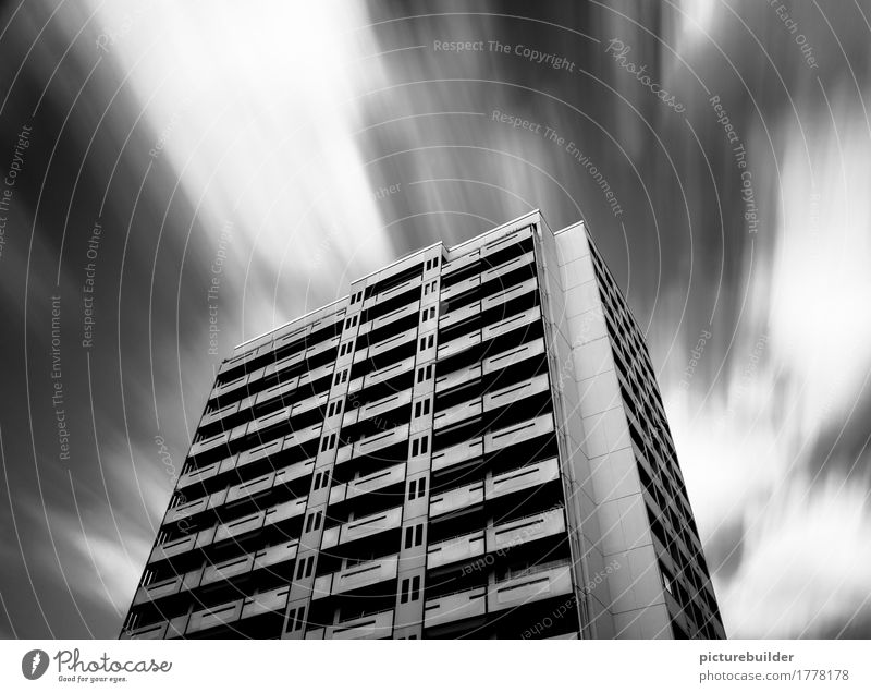 skyscraper Living or residing House (Residential Structure) Sky Clouds Weather Wind Town Deserted High-rise Facade Concrete To hold on Flying Strong Black White