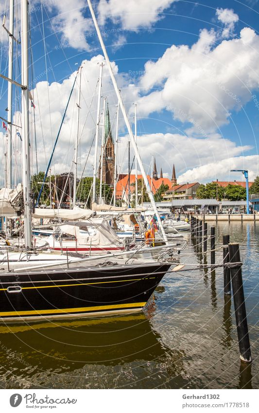 Marina of Schleswig with the Schleswiger Dom in the background Leisure and hobbies Vacation & Travel Tourism Summer Ocean Aquatics Sailing Nature Water Sun