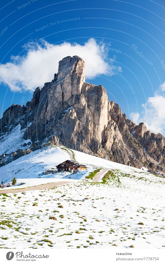 Dolomitic mountain peak after a summer snowfall. Vacation & Travel Tourism Summer Winter Snow Mountain Nature Landscape Rock Alps Peak Hut Building Adventure