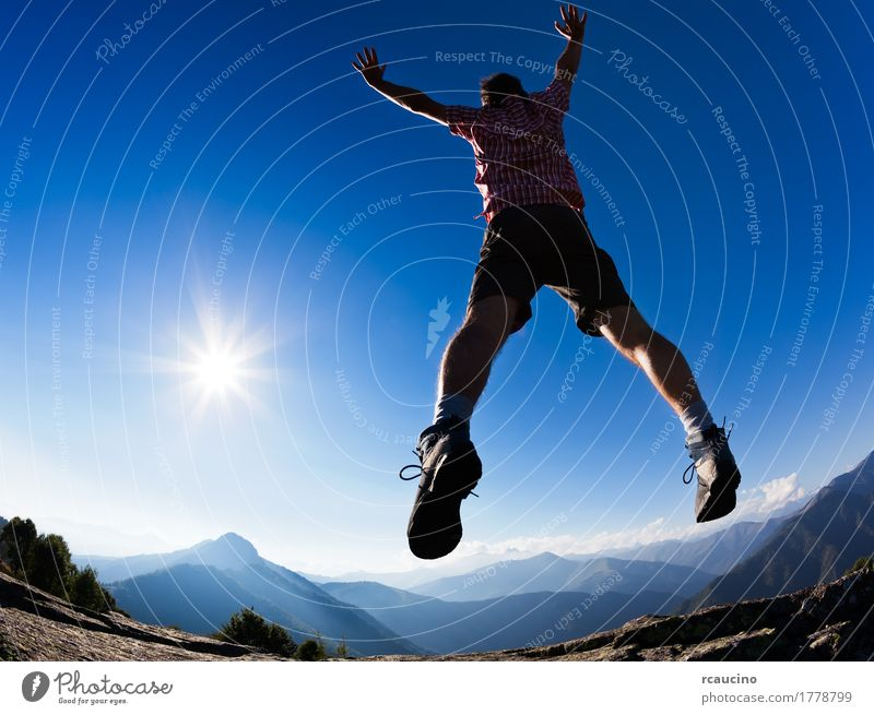 Man jumping in the sunshine against blue sky. Sky Vacation & Travel Blue Summer Sun Landscape Relaxation Loneliness Joy Mountain Adults Lifestyle Freedom Jump