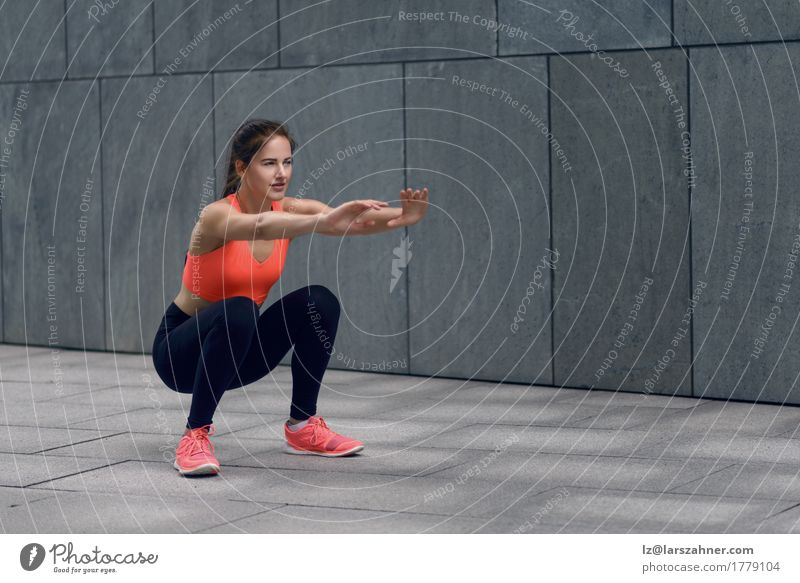 Fit young woman doing squats Human being Woman Youth (Young adults) 18 - 30 years Face Adults Sports Lifestyle Feminine Happy Copy Space Body Smiling Fitness