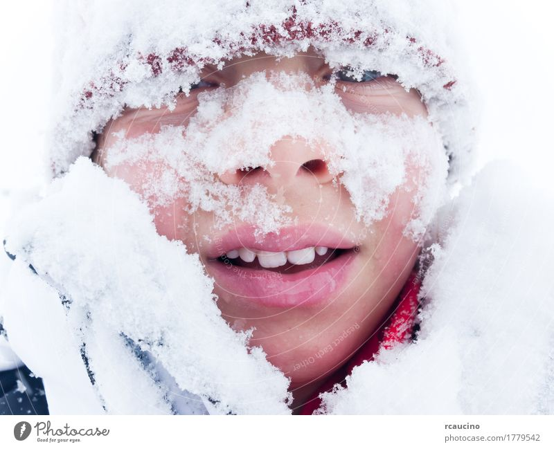 Portrait of a child covered with snow Lifestyle Joy Winter Snow Mountain Child Boy (child) Man Adults Smiling White Loneliness Beret cap Caucasian cold