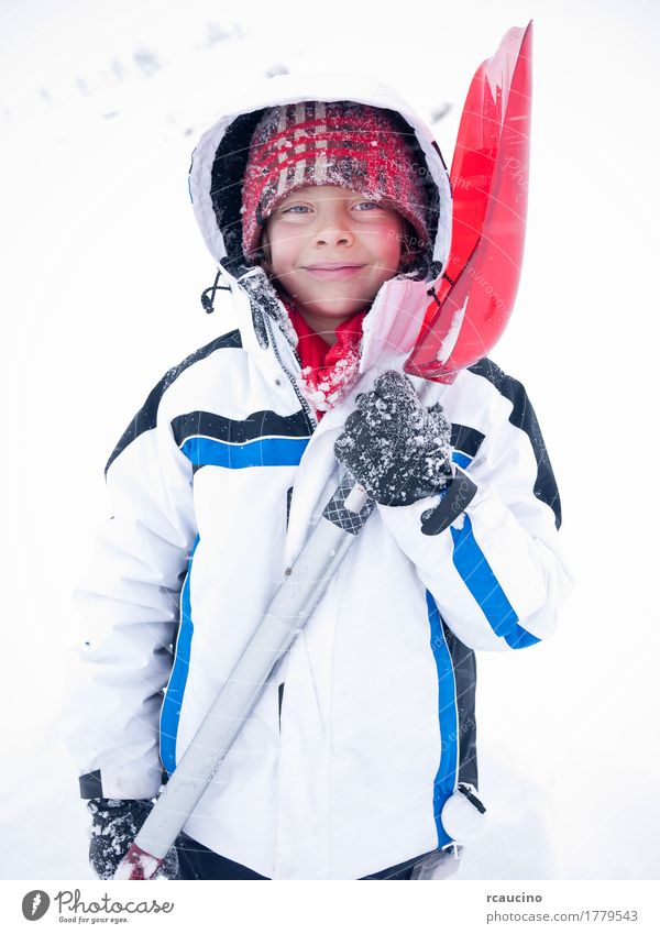 Child portrait winter snow Lifestyle Joy Relaxation Winter Snow Mountain Boy (child) Man Adults Clothing Smiling Blue Red White Beret Caucasian cold ice