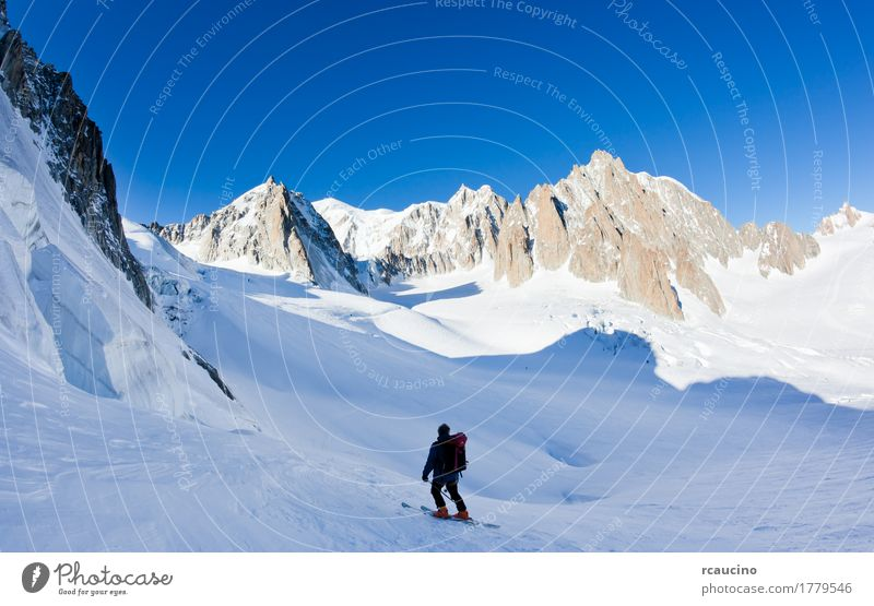 Skier in Mont Blanc Massif, Chamonix, France. Vacation & Travel Tourism Expedition Winter Snow Mountain Man Adults Nature Landscape Sky Alps Glacier White