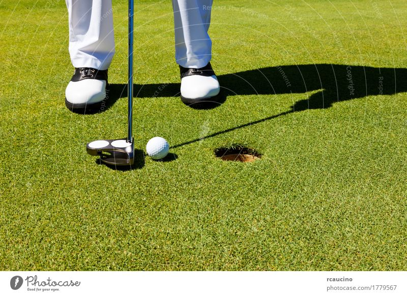 Golf: golfer on the putting green, preparing to put Joy Relaxation Playing Summer Sports Golf course Man Adults Feet Pants Footwear Stand Green White Loneliness
