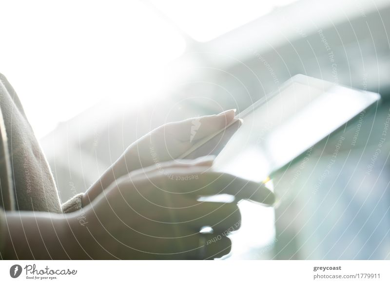Close-up shot of female hands holding touch pad against bright sunlight Computer Young woman Youth (Young adults) Hand 1 Human being Bright Modern