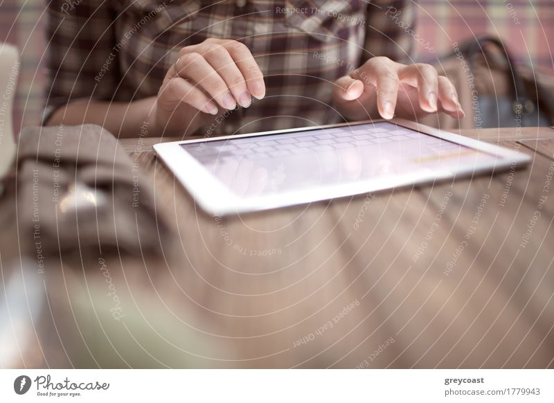 Woman in cafe typing on touch pad Table Computer Internet Human being Young woman Youth (Young adults) Hand Places Wood Modern Café type Touchpad Use tab