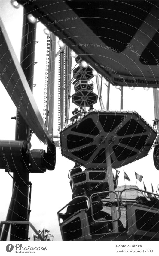 In the Ferris Wheel Fairs & Carnivals Ferris wheel Autumn Leisure and hobbies Tall Black & white photo