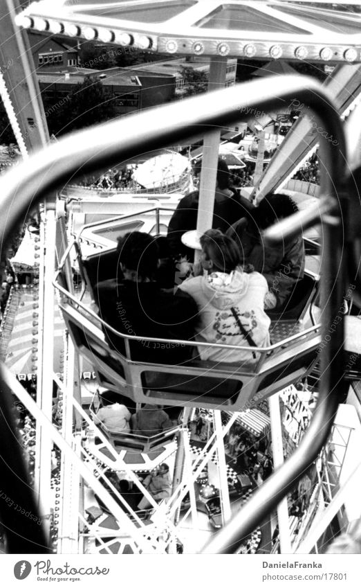 In the Ferris Wheel 2 Ferris wheel Fairs & Carnivals Autumn Leisure and hobbies Tall Black & white photo Human being