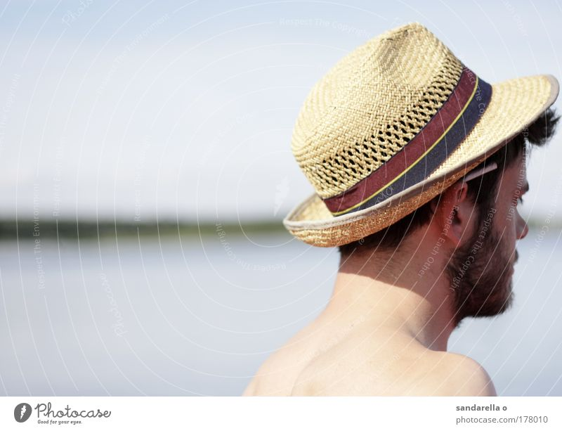 with hat from half back side, cigarette behind ear Subdued colour Exterior shot Copy Space left Day Shallow depth of field Portrait photograph Rear view
