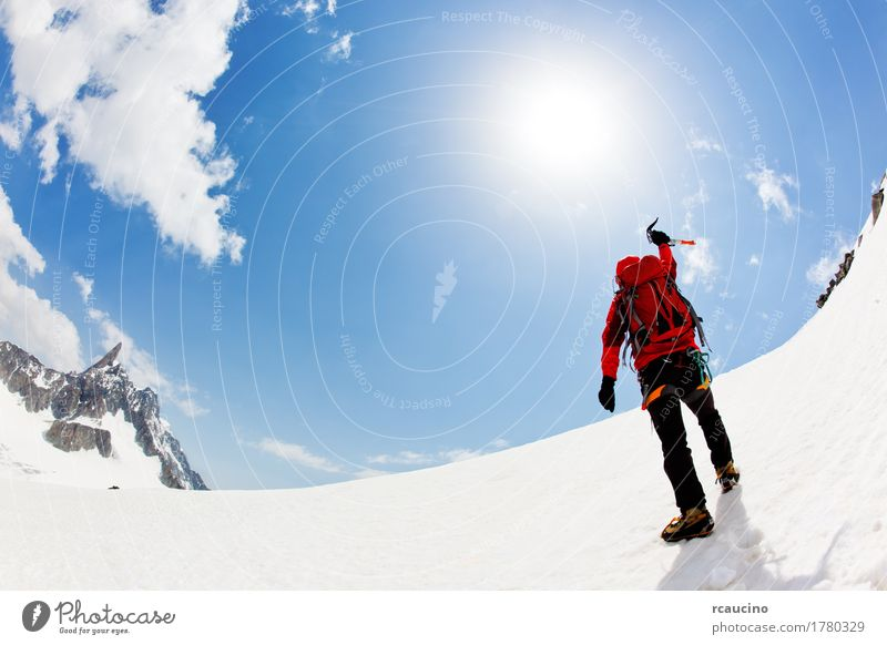 A mountaineer expresses his joy reaching the summit Joy Adventure Expedition Winter Snow Mountain Sports Climbing Mountaineering Success Man Adults Nature