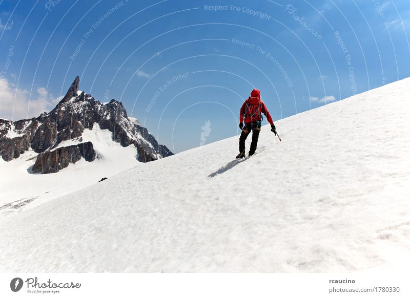 A mountaineer on the way for reach the summit. Chamonix, France Sky Nature Man Blue Landscape Red Loneliness Clouds Joy Winter Mountain Adults Sports Snow