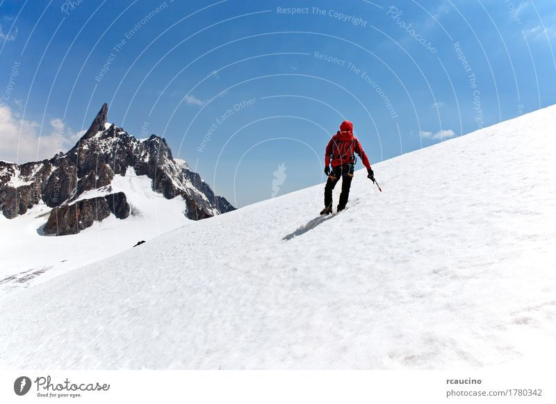 Climber on a glacier, Mont Blanc, Chamonix, France. Sky Nature Man Blue Landscape Red Loneliness Clouds Joy Winter Mountain Adults Sports Snow Success Stand