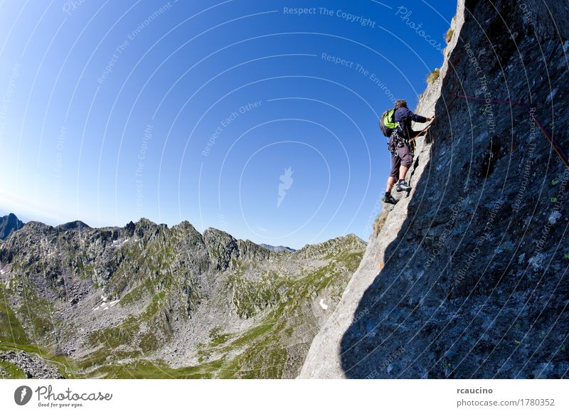 Caucasian male climber climbing a steep wall Sky Nature Vacation & Travel Man Blue Summer Landscape Mountain Adults Sports Rock Italy Adventure Rope Alps