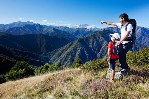 Man and young boy standing in a mountain meadow Lifestyle Relaxation Vacation & Travel Tourism Summer Mountain Hiking Sports Child Human being Boy (child)