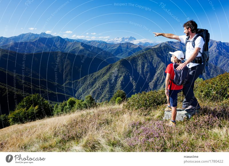Man and young boy standing in a mountain meadow Human being Child Sky Nature Vacation & Travel Summer White Landscape Red Relaxation Mountain Adults Lifestyle