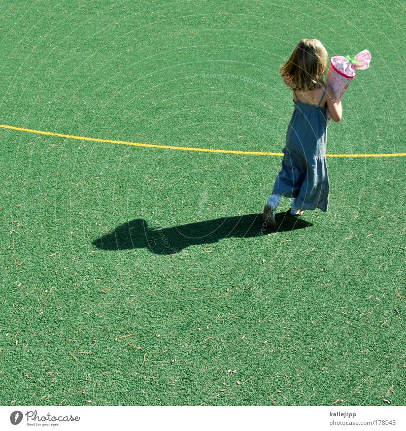 Good luck. Colour photo Multicoloured Exterior shot Copy Space bottom Day Light Shadow Contrast Sunlight Full-length Rear view Football pitch Parenting