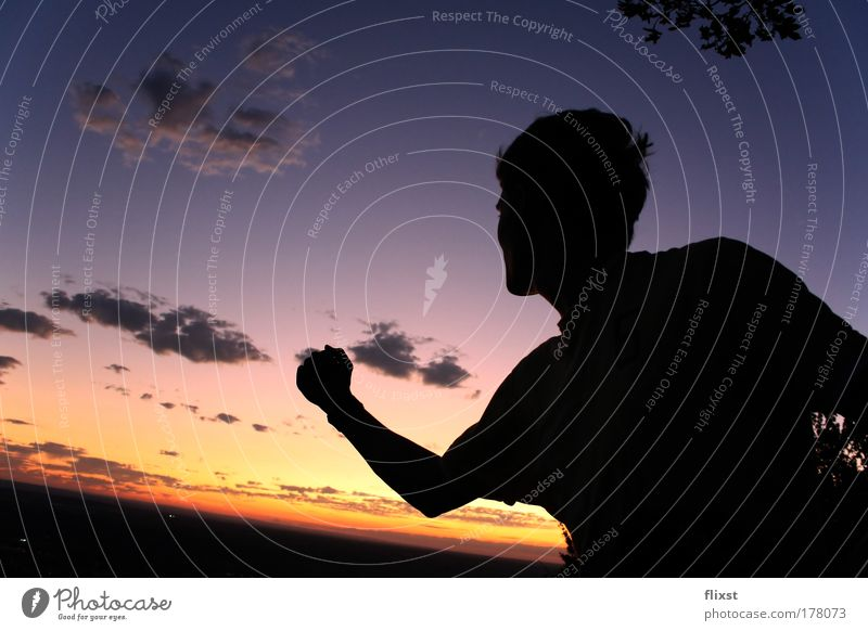 The world is yours Colour photo Exterior shot Copy Space right Twilight Silhouette Sunrise Sunset Deep depth of field Wide angle Upper body Half-profile Forward