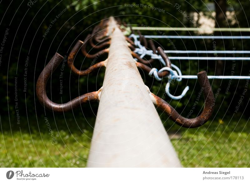 leash Colour photo Exterior shot Detail Deserted Day Garden Meadow clothes pole Clothesline Checkmark Metal Line Old Trashy Gloomy Blue Brown Gray Green