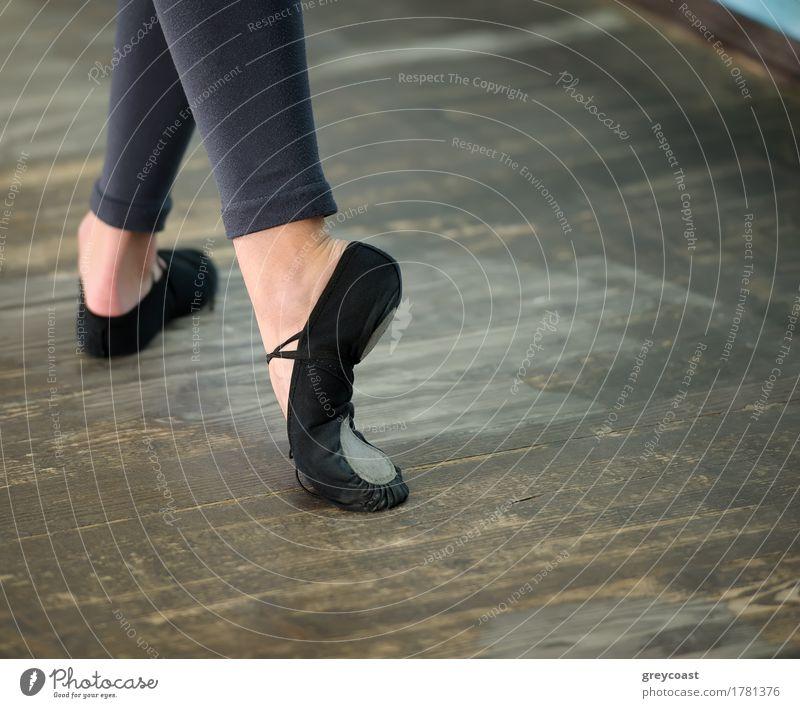 Ballerinas legs in black pointes on wooden floor in point position Elegant Style Beautiful Dance School Profession Girl Woman Adults Feet Dancer Ballet Footwear