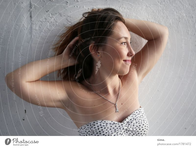 . Feminine 1 Human being Wall (barrier) Wall (building) Dress Jewellery Necklace Brunette Long-haired Relaxation Smiling Looking Friendliness Happiness